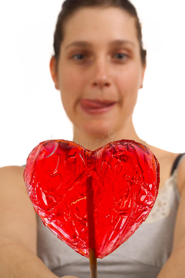 Young woman can't wait to lick lollipop royalty free stock photo