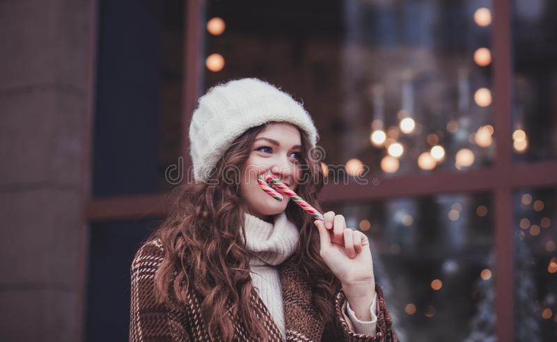 Young woman with candy on the festive Christmas day stock photo