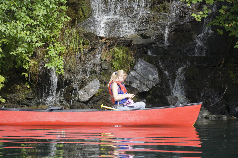 Download Young woman canoeing stock image. Image of lakeshore, rock - 6988491