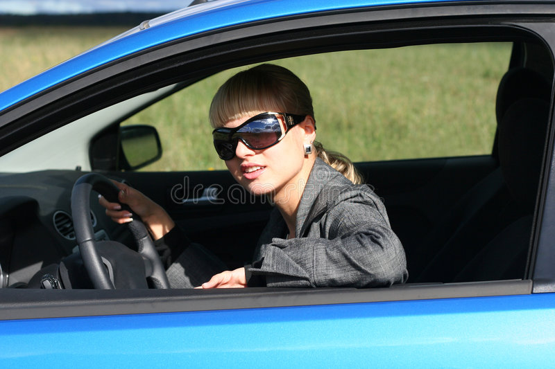Young woman in car stock images