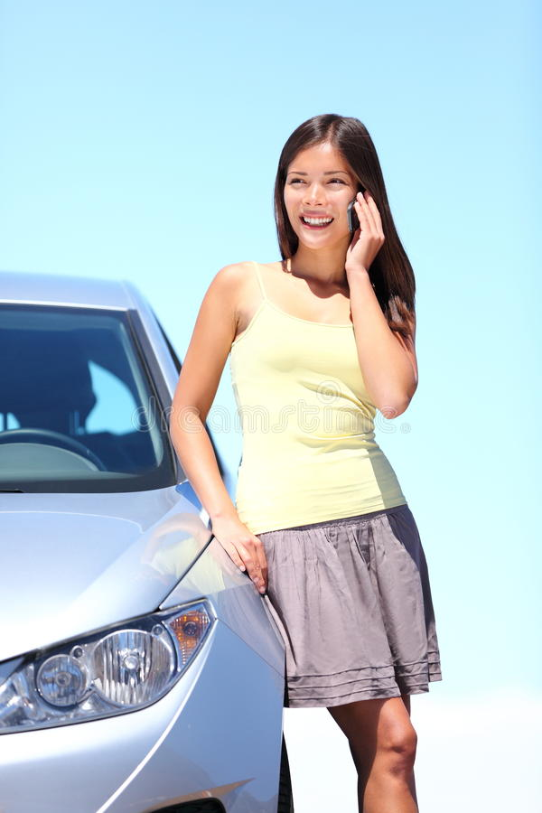 Download Young Woman By Car On Mobile Phone Stock Image - Image: 19412767