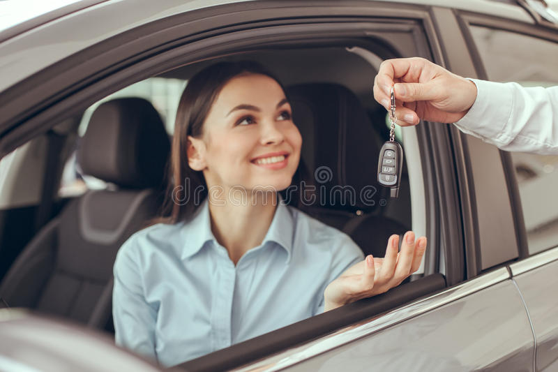 Young Woman in a Car Rental Service Test Drive Concept royalty free stock images