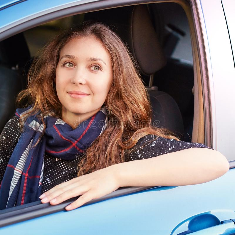 Young woman in car. Ride instruction. Automobile loan.  royalty free stock photography