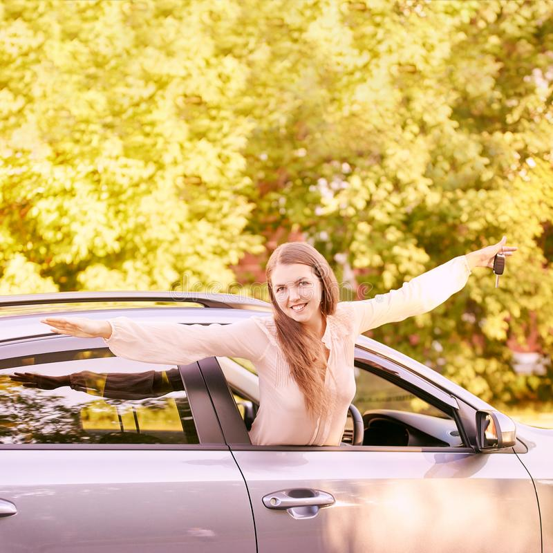 Young woman in car. Ride instruction. Automobile loan.  stock images