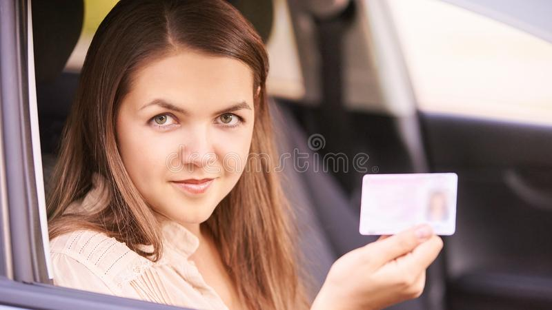 Young woman in car. Ride instruction. Automobile loan.  royalty free stock images