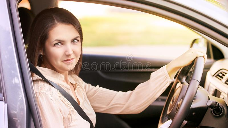Young woman in car. Ride instruction. Automobile loan. Young woman in car. Ride instruction accident. Automobile loan stock photos