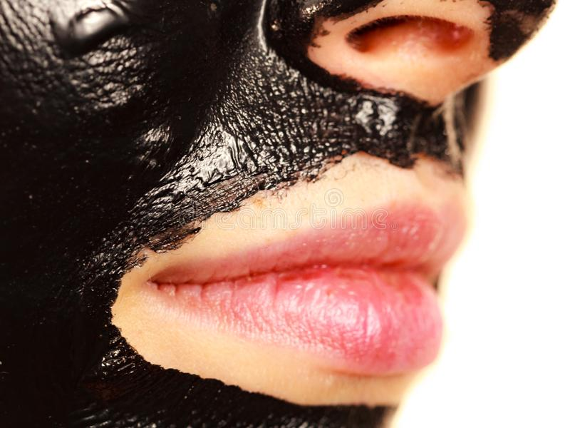 Girl black carbo peel off mask on face stock images