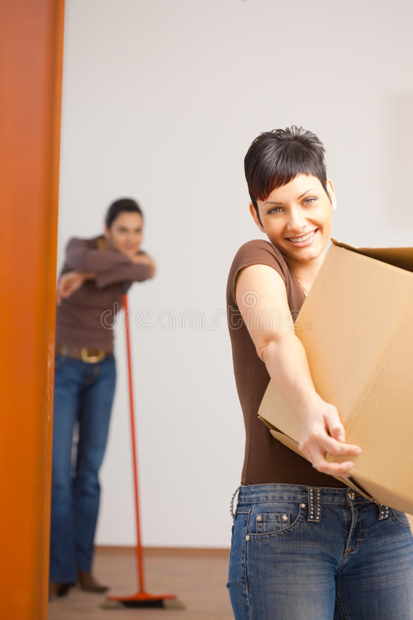 Download Young Woman With Cardboard Box Stock Photo - Image of heavy, empty: 10698150