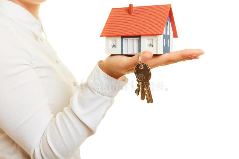Woman carries house and keys as a house construction concept royalty free stock images
