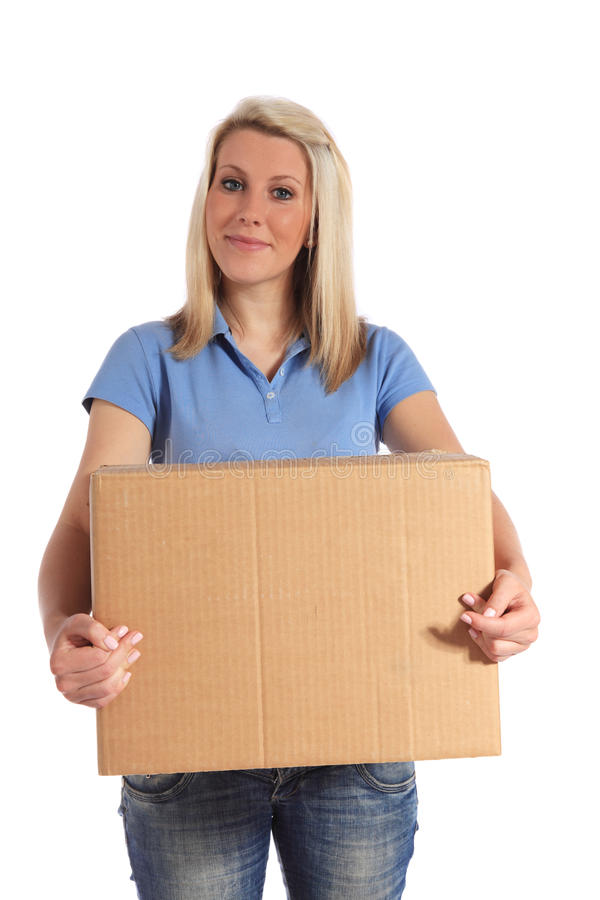 Young woman carrying a moving box stock photos