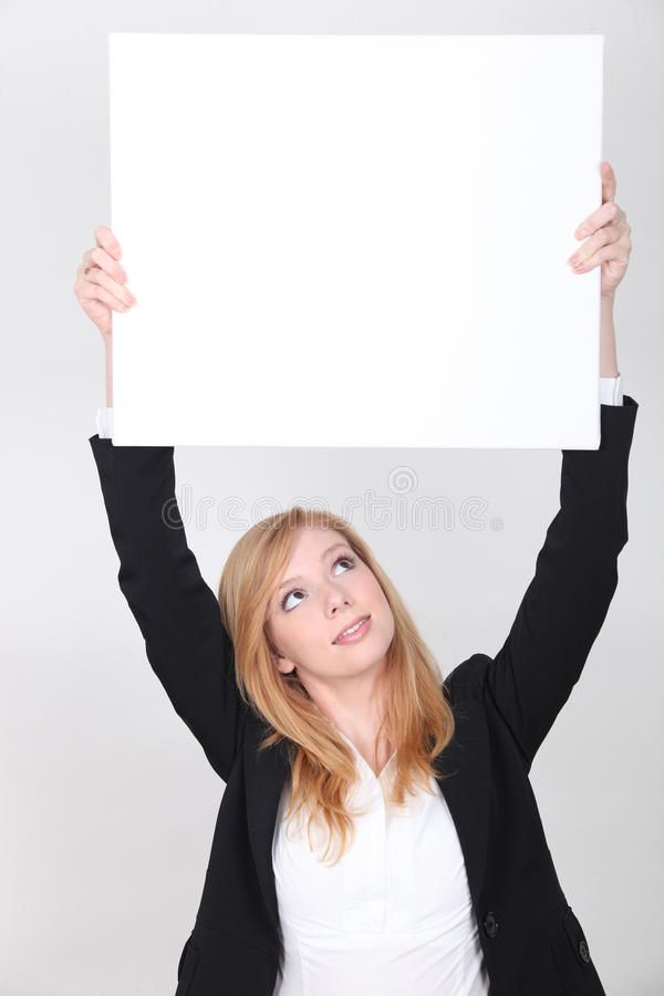 Young woman carrying white panel