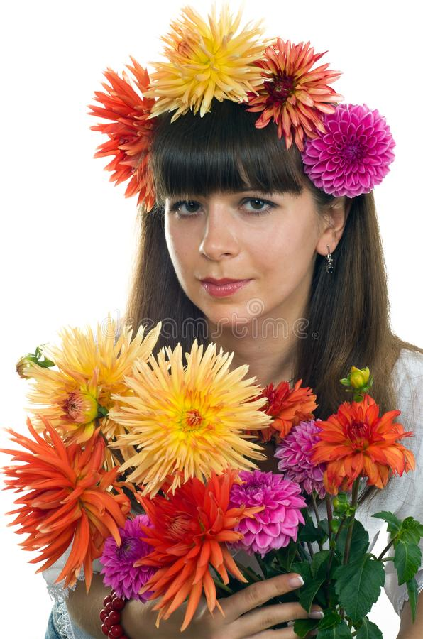 Young smiling girl with flowers dahlias stock image