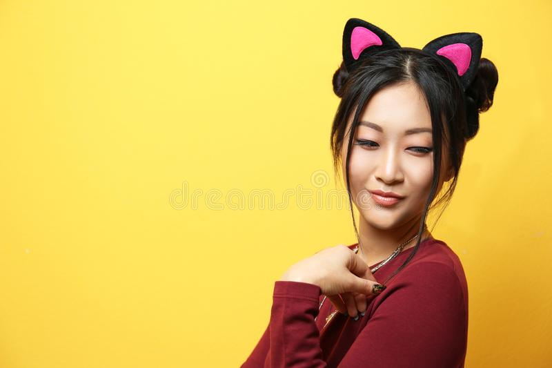 Young woman in cat ears stock images
