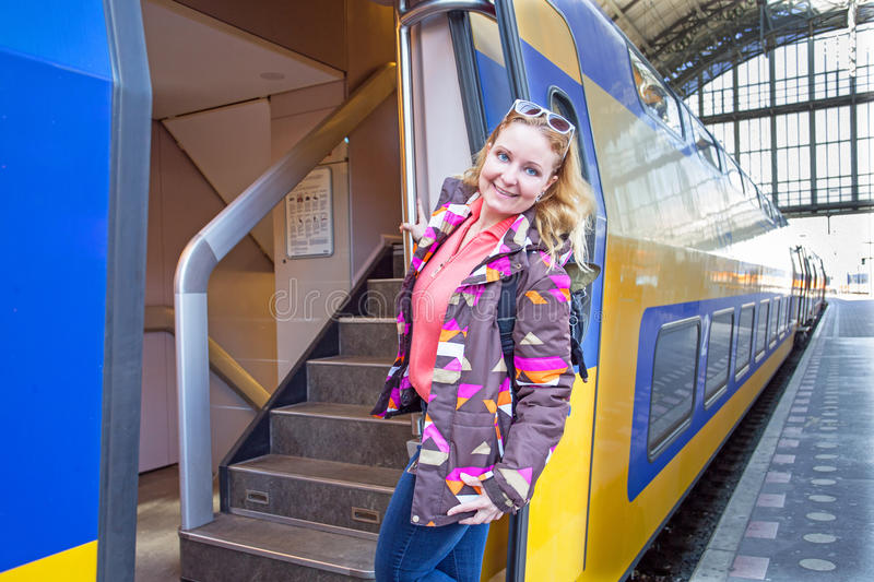 Young woman catching the train in Amsterdam central station in t. He Netherlands royalty free stock images