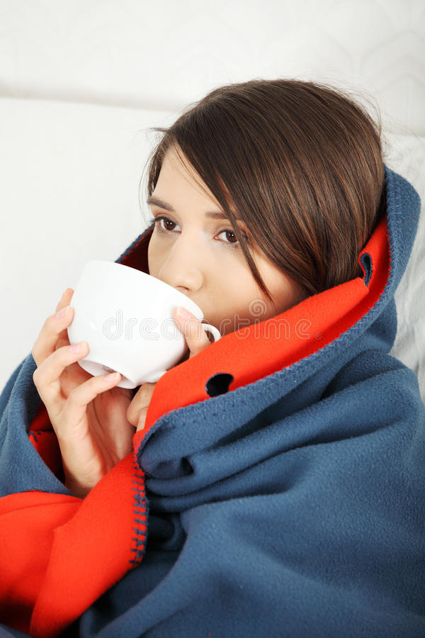 Young woman caught cold. royalty free stock images