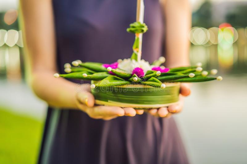 Young woman celebrates Loy Krathong, Runs on the water. Loy Krathong festival, People buy flowers and candle to light. And float on water to celebrate the Loy stock photos