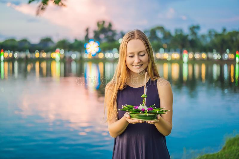Young woman celebrates Loy Krathong, Runs on the water. Loy Krathong festival, People buy flowers and candle to light. And float on water to celebrate the Loy stock images