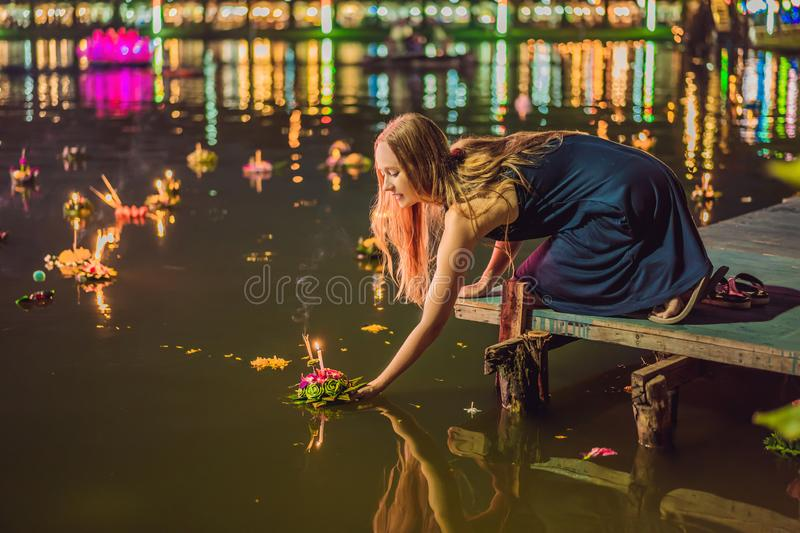 Young woman celebrates Loy Krathong, Runs on the water. Loy Krathong festival, People buy flowers and candle to light. And float on water to celebrate the Loy royalty free stock image