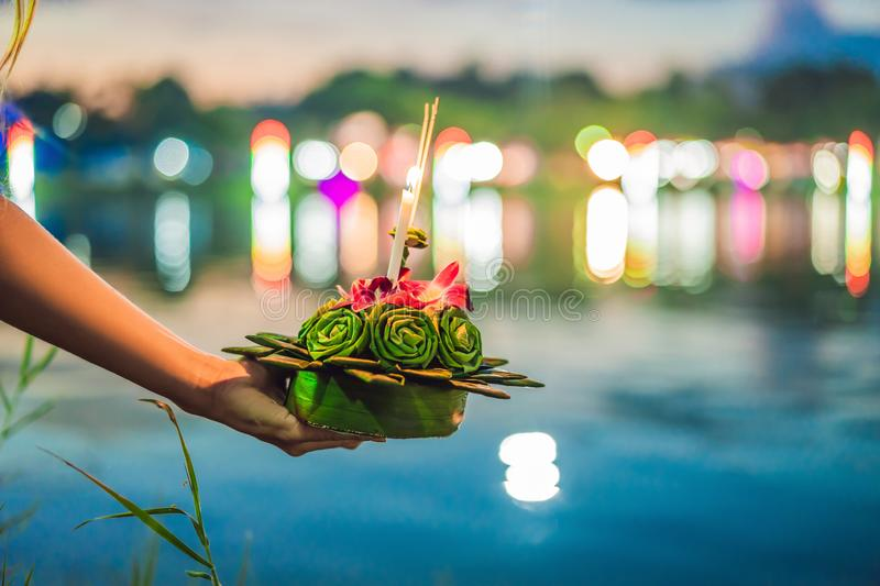 Young woman celebrates Loy Krathong, Runs on the water. Loy Krathong festival, People buy flowers and candle to light. And float on water to celebrate the Loy royalty free stock photography