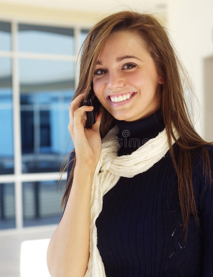 Young woman on cell phone stock photography
