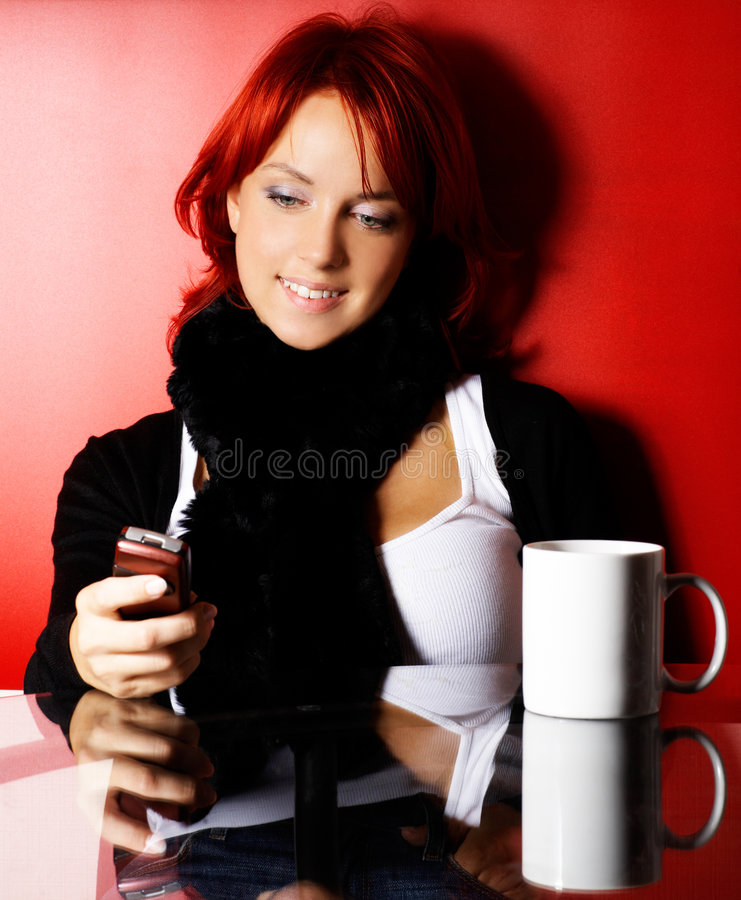 Young woman with cell phone stock image