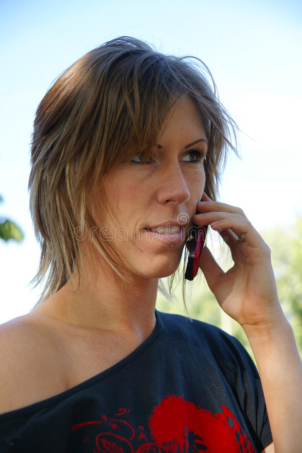 Download Young woman with cellphone stock image. Image of looking - 20399909