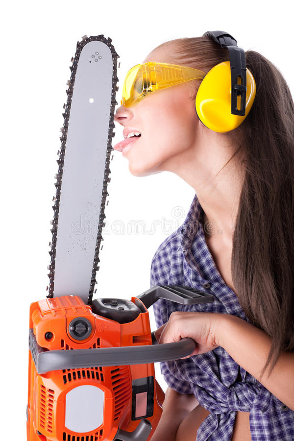 Young woman with a chainsaw stock photos