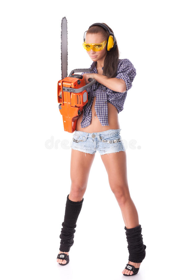 Young woman with a chainsaw royalty free stock photos
