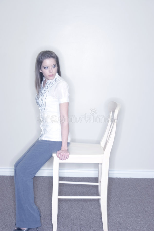 Young Woman on Chair royalty free stock photos