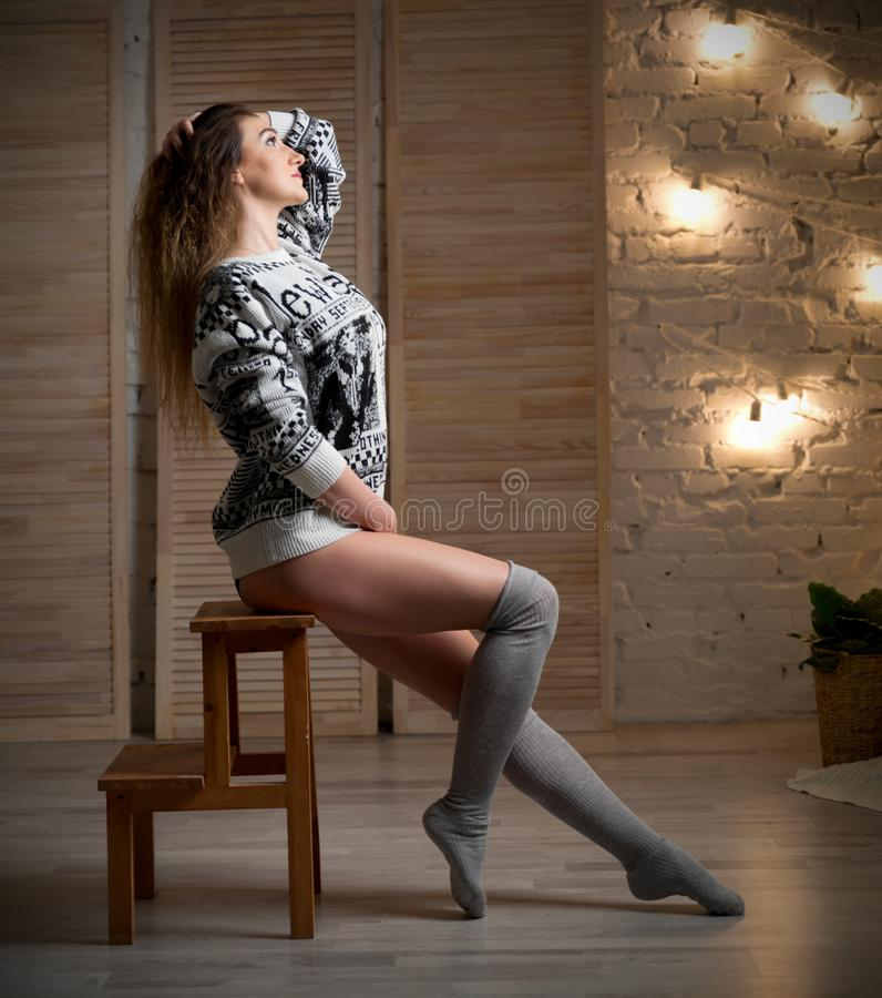 Young woman on the chair stock image