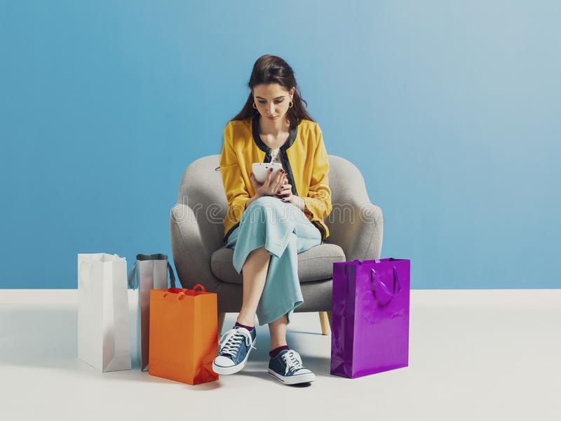 Young woman checking fashion shopping sales online royalty free stock image