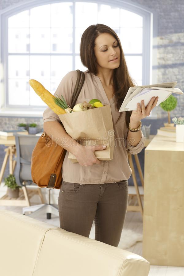 Download Young Woman Checking Mail Upon Arrival At Home Royalty Free Stock Photo - Image: 35810275