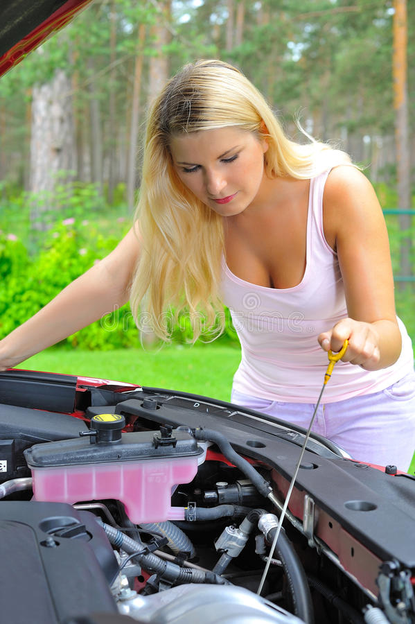 Free Young Woman Checking Oil Level In The Car Stock Image - 17247381