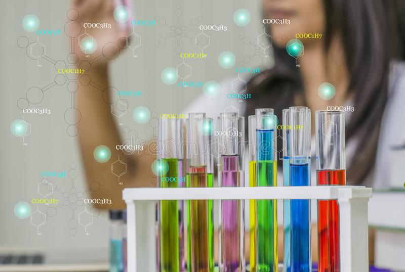 Young woman chemist,Work laboratory,Check test kit in hand with test samples,. Work with colorful liquid chemicals,In glass tubes for cosmetics,To develop safe royalty free stock photo
