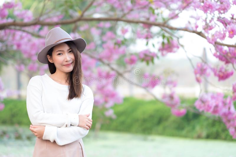 Young woman in cherry blossom garden in Spring day royalty free stock photos