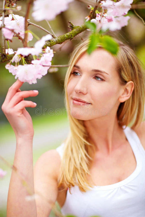 Young Woman With Cherry Tree Royalty Free Stock Photo