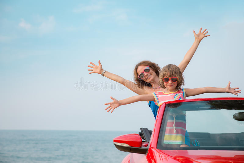 Young woman and child relaxing on the beach stock photos
