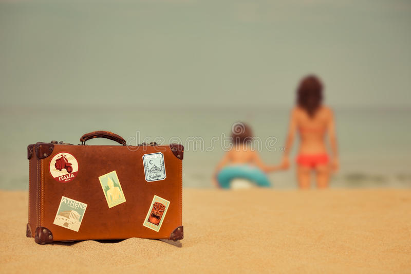 Young woman and child relaxing on the beach stock photography
