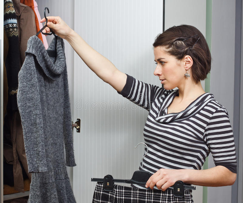 Download Young Woman Choosing Clothes Stock Photo - Image: 23658426