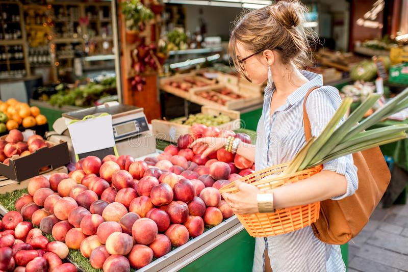 Woman at the food market stock photos