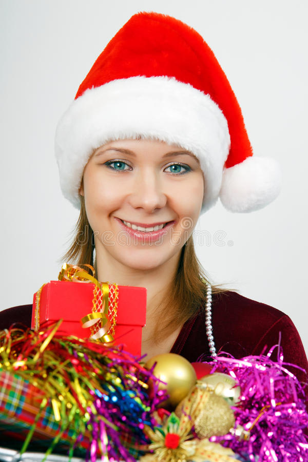 Young woman with Christmas decorations. Portrait of a smiling attractive young woman with Christmas decorations stock photography