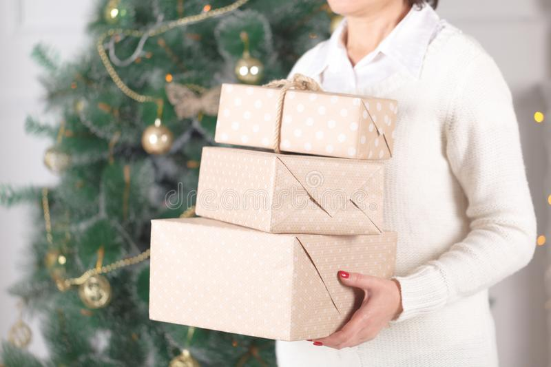 Young woman with christmas gifts stock photo