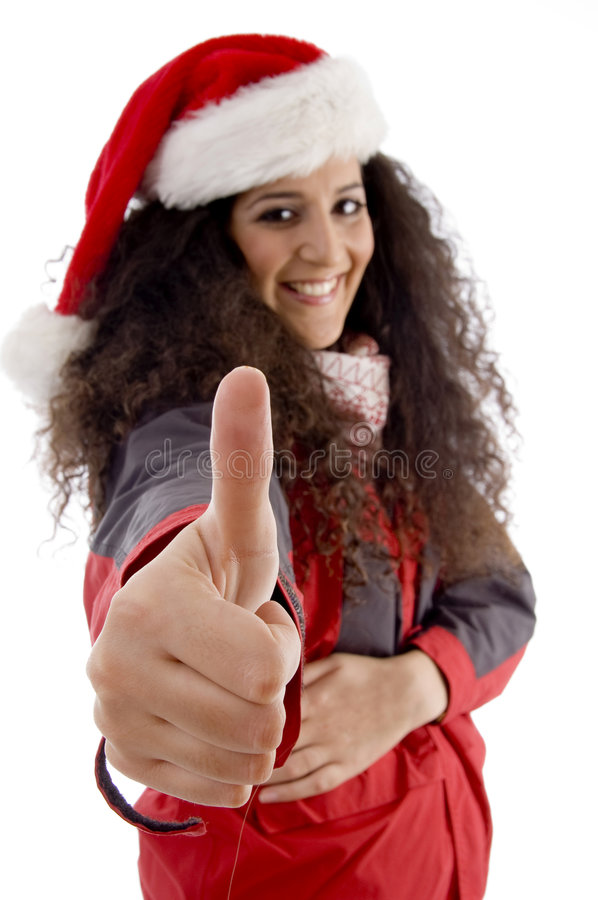 Young woman with christmas hat showing thumb up