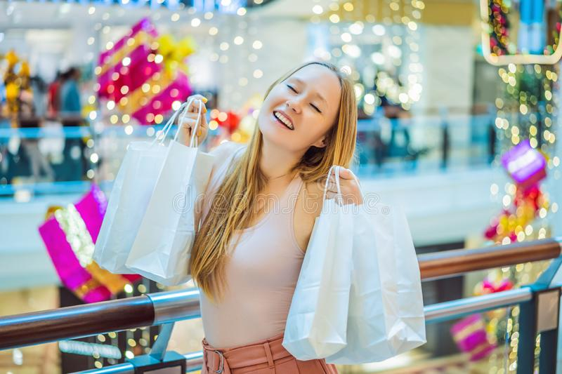Young woman in Christmas mall with Christmas shopping. Beauty bu stock images
