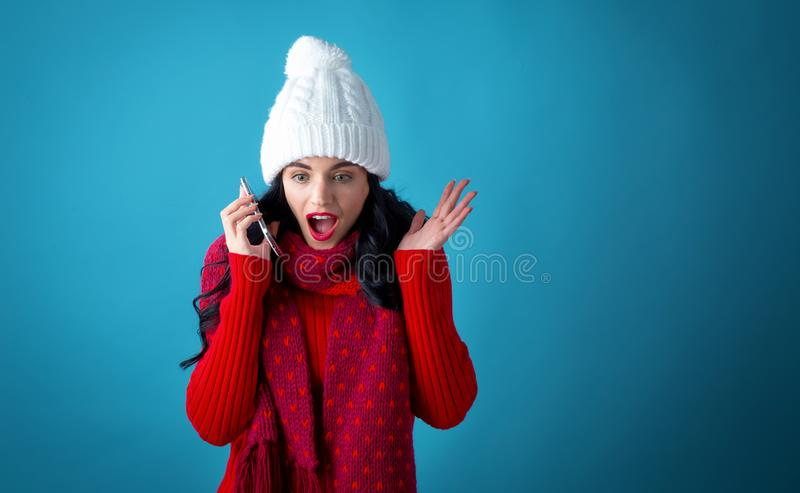 Young woman with Christmas theme using her phone royalty free stock photos