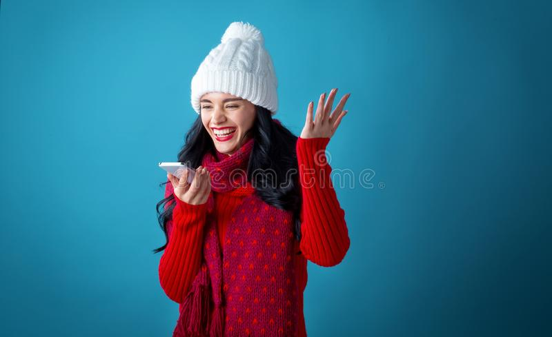 Young woman with Christmas theme using her phone royalty free stock image
