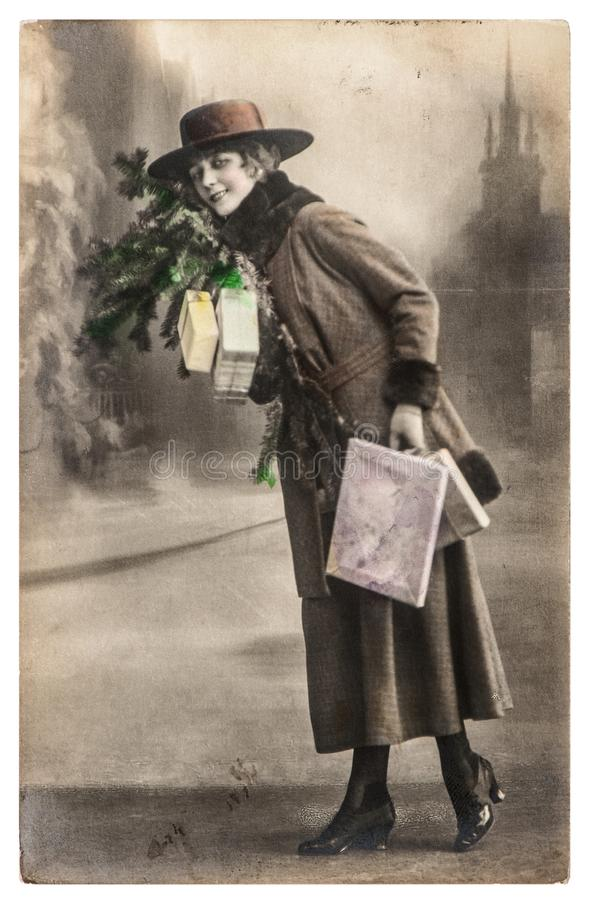 Young woman christmas tree gifts Vintage picture. Young woman with christmas tree and gifts. Vintage picture with original film grain and blur stock images