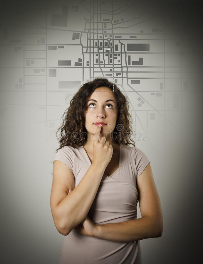 Young woman and city map. stock photo