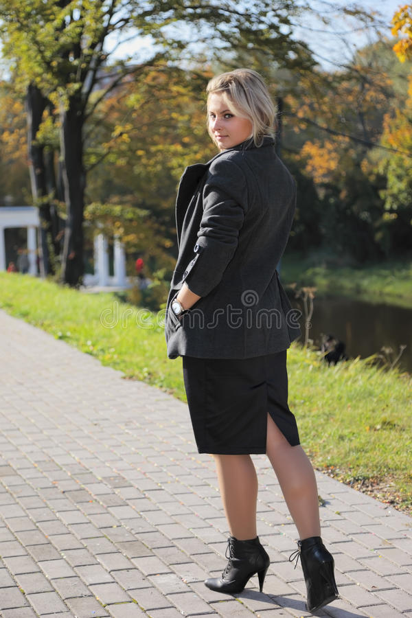 Download Young woman in city park stock image. Image of jacket - 17168473