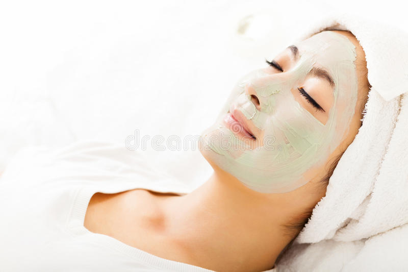 Young woman with clay facial mask. Young beautiful woman with clay facial mask stock photos